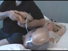 Babe bound in plastic wrap giggles while tickled