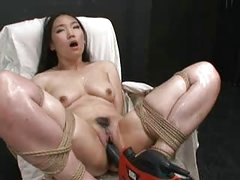Hot Asian girl fastened and screwed with fucking machine