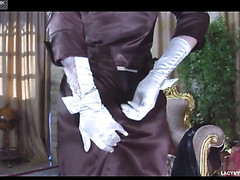 Glam sweetheart putting on vintage six-strap nylons with a fancy hat and gloves