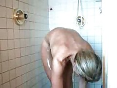 Sour faced doxy having shower, booty naked talking to husband, small titties and a firm constricted body, shaved pussy.