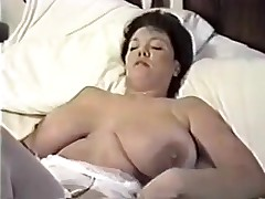 This homemade clip is a mix of sexy clip scenes I have taken of my huge-titted wife. U can see her strip, give me blowjob, shave her cunt, masturbate during the time that I fuck her, play with sex toys and take a bath.