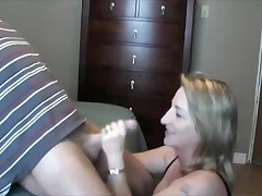 This lady can't live without to handle and suck her husband's cock.  This hottie sucks it, puts on some flavored lube, and the strokes the shaft during the time that this hottie tonguing the tip in her mouth.  That chap finally cums in her mouth, moaning, and this hottie swallows, with just a little bit of the cum dribbling out.