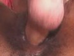 Juicy black cum-hole gets nailed by meaty big white cock, which slides back and forth inside this trickling pussy.
