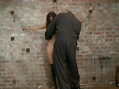 Our cute floozy Casey wears a couple of high heels boots and no thing more. This babe looks good like that and the executor is happy to chastise her sexy body. He tied her on the wall, ball gagged her and used a rope to pull her body up while that babe was still tied on that wall. Look how much that babe suffers and endures for our fun