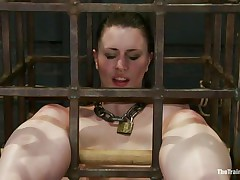 That chick was a bad girl and they had to put her in a cage and reeducate her. Now this chick is receiving what this chick deserves, a hard spank and some well merited humiliation. Of course her bald cum asking twat is not to be neglected and the executor uses a fake penis to taunt her a bit. Want to this chick the rest of it?