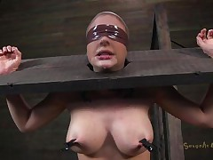 Clamps with weights were attached on her big boobs and duct tape was used to blindfold her. Now she stays there in that thraldom device and has a rodeo sex machine underneath her that's rubbing her hairless pussy. To make things interesting an executor comes and deeply mouth bonks this slut girl, chocking her with rod