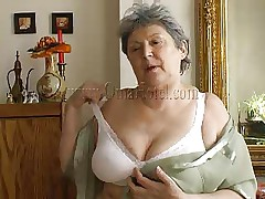 Granny takes off her shirt and bra and her heart rate increases as this hottie starts massaging those large saggy boobs. Just like in her youth this fucking doxy takes off her clothes to pleasure men! Granny removes those white pants and reveals her saggy hairy cookie that she's enjoys rubbing. What she's up to next?