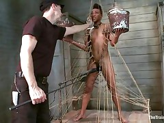 Nikki is all bound up and standing on her legs. Filled with clothespins and strings, this honey has to be careful and not to drop the two buckets she`s holding, during the time that a big sextoy makes sensations on her soaked cunt. This honey receives all whipped for being such a bad ebon girl. Her executor will take very wonderful care of her!