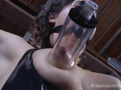 Brunette Marina wearing a black latex costume and having a large black ball gagging her face hole is about to be punished by her executor. The guy begins with her zeppelins and uses very large suckers to torture 'em and when Marine's nipples are hard he ties 'em with rubber bands. Appears to be that babe will stay there for a long time