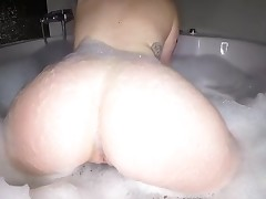 Playing with her own gigantic knockers makes honey very horny
